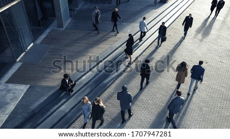 Office Managers and Business People Commute to Work in the Morning or from Office on a Sunny Day on Foot. Pedestrians are Dressed Smartly. Successful People Walking in Downtown. Shot from Above. Royalty-Free Stock Photo #1707947281