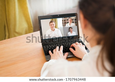 online conference. Businesswoman using laptop making video call to business partner. Home office. Group of people smart working from home. #1707963448