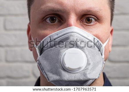 Protection against contagious disease, coronavirus. Man wearing hygienic mask to prevent infection, airborne respiratory illness such as flu, 2019-nCoV #1707963571
