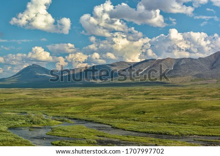 """Tundra in the foothills of the Polar Urals. View of the Main Ural ridge from the window of the train """"Moscow-Labytnangi""""."""