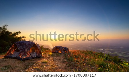 Landscape of sunrise or sunset over tent in nation park. Concept camping or picnic with eco vacation #1708087117