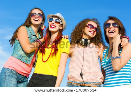 Image of four young attractive girls having fun outdoors #170809514