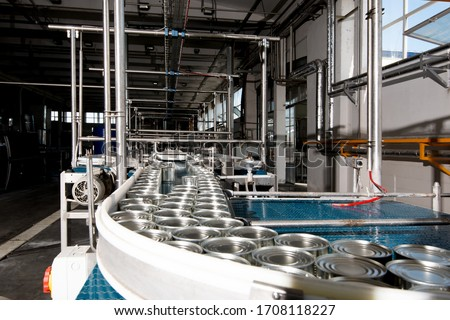 aluminum cans for food processed in factory line conveyor machine at canned food manufacturing, selective focus  #1708118227
