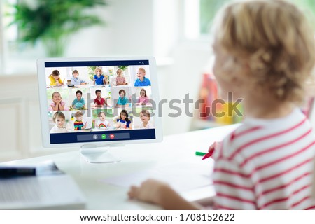 Online remote learning. School kids with computer having video conference chat with teacher and class group. Child studying from home. Homeschooling during quarantine and coronavirus outbreak. #1708152622