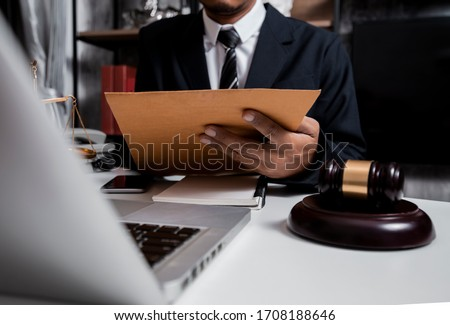 Justice and law concept. Lawyer businessman working with document on table office.