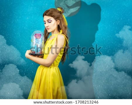 Woman in the yellow dress with red rose in her hands on the background of the beast . Beauty and the beast cosplay art processing. Beauty and the beast cosplay  #1708213246