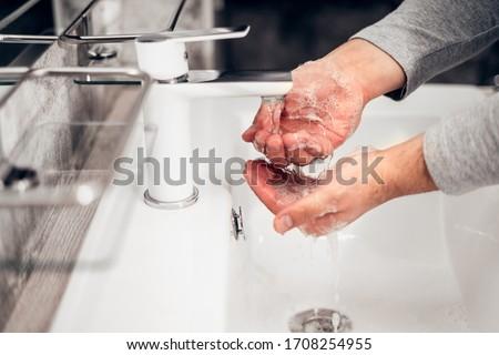 Coronavirus. Proper washing and handling of hands. Liquid antibacterial soap. Self-isolation and hygiene #1708254955