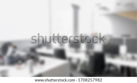 Blurred empty open space office. Abstract light bokeh at office interior background for design.