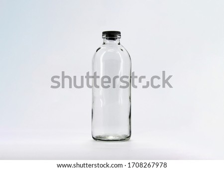 Empty glass bottle isolated on white background.Mock up.High resolution photo.