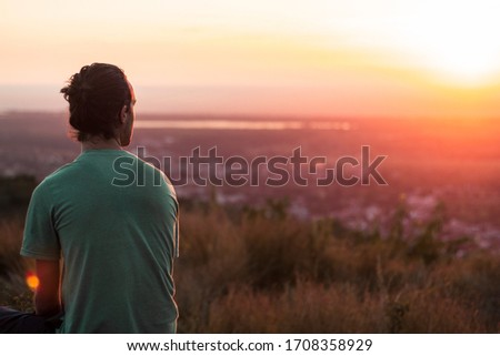 A man from the back enjoying a stunning sunset in Trinidad, Cuba #1708358929
