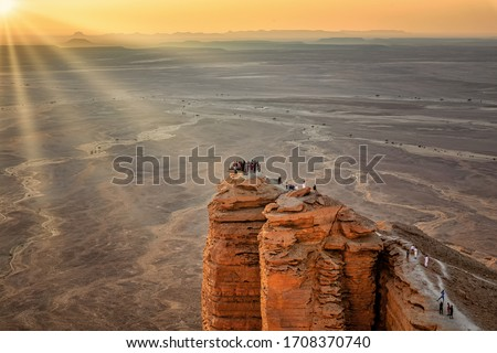 Sun rays on Edge of the World, a natural landmark and popular tourist destination near Riyadh -Saudi Arabia. #1708370740