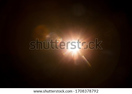 Abstract Natural Sun flare on the black #1708378792