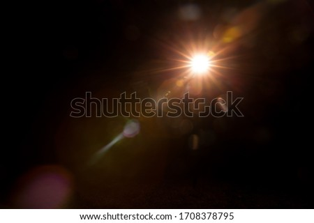 Abstract Natural Sun flare on the black #1708378795