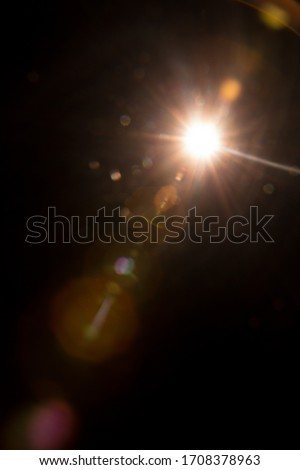 Abstract Natural Sun flare on the black #1708378963