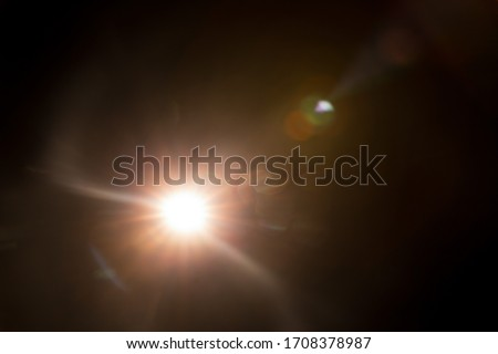 Abstract Natural Sun flare on the black #1708378987