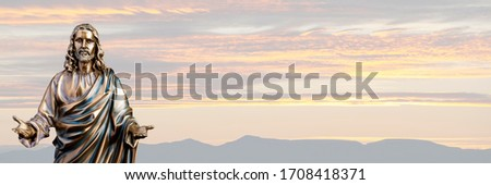 A bronze statue of a Jesus Christ with a sunset background #1708418371
