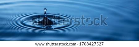 Water splash or water drop.Water drop in sunlight. Royalty-Free Stock Photo #1708427527