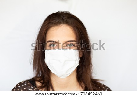 portrait of beautiful young woman wearing cotton white mask and medical/surgical gloves on white background.  #1708452469