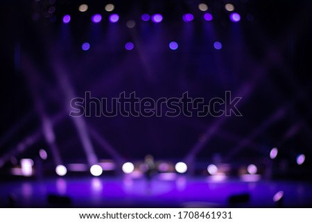 Texture blur and defocus, background for design. Stage light at a concert show. Royalty-Free Stock Photo #1708461931
