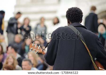PARIS, FRANCE - MAY 15: male musician playing in the street near Sacre Coeur for money on May 15, 2009, in Paris, France. Place on the steps of Sacre Coeur, one of the most beloved places in Paris #170846522