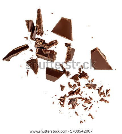 Flying Dark chocolate pieces isolated on white background.  Chocolate bar chunks, shavings and cocoa crumbs Top view. Flat lay #1708542007