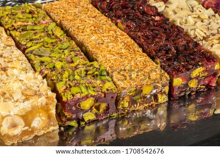 Turkish delight types with dried fruits and dried fruits on a black background Royalty-Free Stock Photo #1708542676