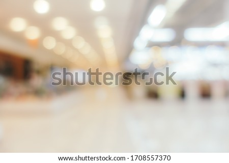 Abstract blur and defocus shopping mall in department store interior for background Royalty-Free Stock Photo #1708557370