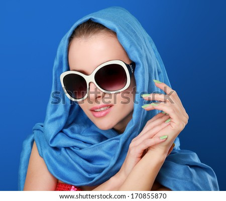 Portrait of an attractive young woman in sunglasses. Retro style #170855870