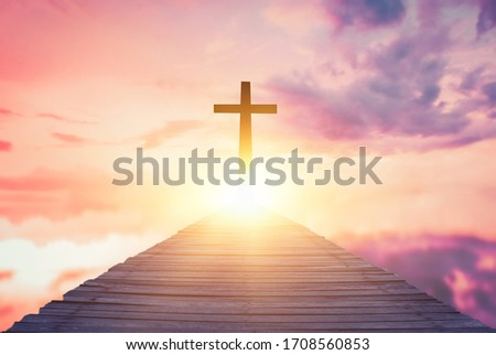 Picture of a wooden cross on an old wooden bridge,Religious concepts