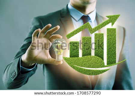 Green economy growth concept with businessman Royalty-Free Stock Photo #1708577290