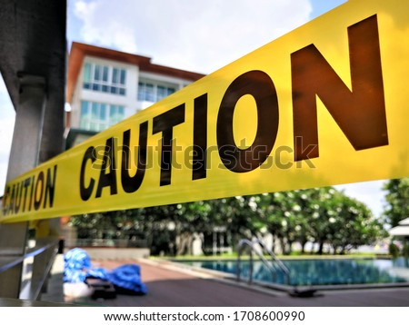 Caution tape and blurred law enforcement and forensic background Royalty-Free Stock Photo #1708600990