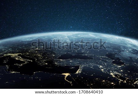 Beautiful planet earth with night city lights. Europe and Africa at night viewed from space with city lights showing human activity in Germany, Poland, Italy, Egypt, Greece and other countries. #1708640410