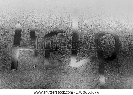 Condensation on the glass with smudges of drops. Caption Help. Space for text. Background. Black and white photo.