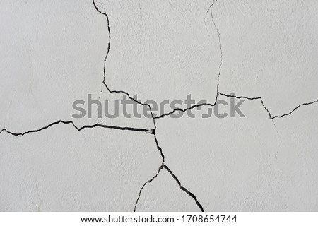 Ð¡racks in the white wall. Texture of cracks in a old wall                                Royalty-Free Stock Photo #1708654744