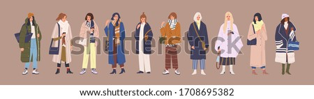 Set of fashion woman in trendy clothes vector cartoon illustration. Collection of classy colorful street style outwear female isolated. Fashionable girl demonstrate winter, spring and autumn clothing Royalty-Free Stock Photo #1708695382