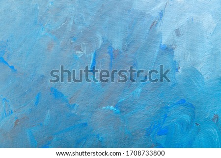 Blue painted canvas with brush strokes as a background #1708733800