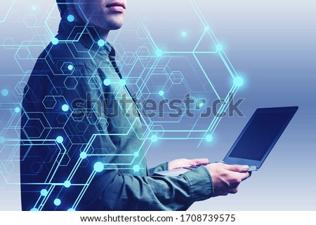 Unrecognizable young engineer using laptop over blurry grey background with double exposure of futuristic AI brain hologram. Concept of internet of things and machine learning. Toned image #1708739575
