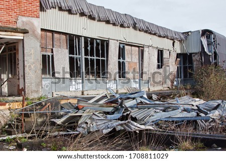 A derelict factory building in Devon UK Royalty-Free Stock Photo #1708811029