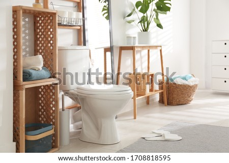 Interior of stylish bathroom with toilet bowl and decor elements #1708818595