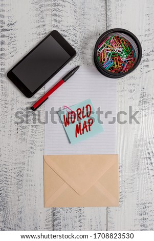 Word writing text World Map. Business concept for a diagrammatic representation of the surface of the earth Smartphone paper sheet clips holder pen envelope note wooden background. #1708823530