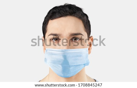 Young boy wearing a protective face mask #1708845247