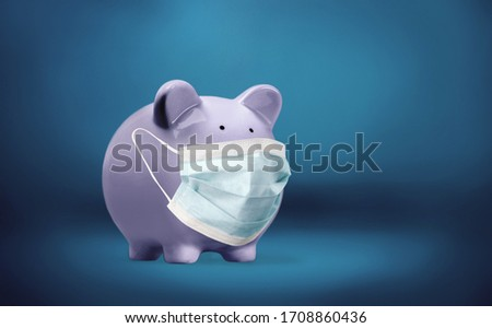 Cute piggy bank, wearing a protective face mask #1708860436