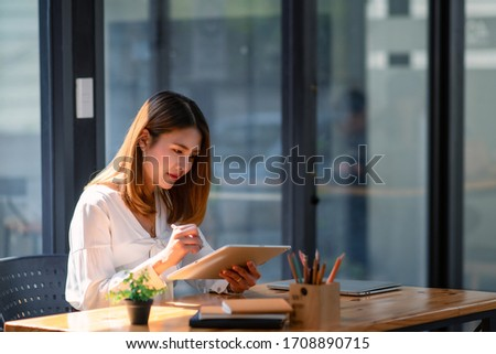 Women stay home use tablet work at home. Royalty-Free Stock Photo #1708890715