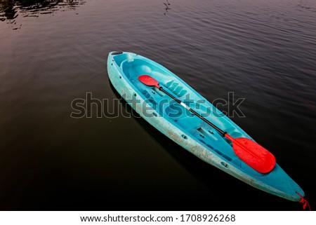 Blue Canoe on river. kayaking on lake.Water activity