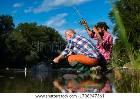 Nice day for fishing. Bearded men catching fish. Off limits fishing. Fishermen fishing equipment. Fisher fishing equipment. Catch me if you can. Fisherman with rod fish and beer #1708947361