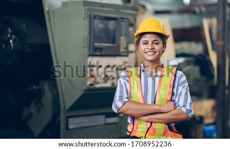 Smile technician engineer women  in factory Royalty-Free Stock Photo #1708952236