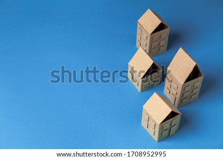 Cardboard houses on blue background, concept of small cozy city, friendly neighbors. Private property, real estate. #1708952995