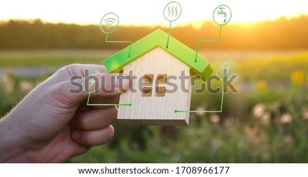 Miniature house and symbols of public utilities. Choosing a home to buy, assessing the cost and condition of the building. Location in the city. Repair and renovation, maintenance services. #1708966177