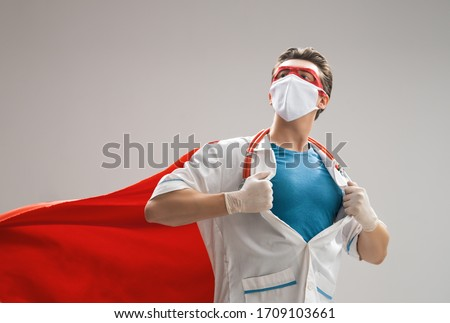 Doctor wearing facemask and superhero cape during coronavirus outbreak. Virus and illness protection, quarantine. COVID-2019. Super hero power for  medicine. Royalty-Free Stock Photo #1709103661