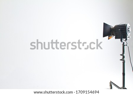 Isolated standing light or spotlight lighting in an empty white photography studio with copy space #1709154694